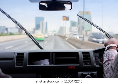Windshield wipers from inside of car, rainy season