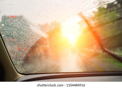 Windshield wipers from inside of car, season rain,filter color effect.