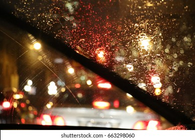 Windshield wipers at night with rain