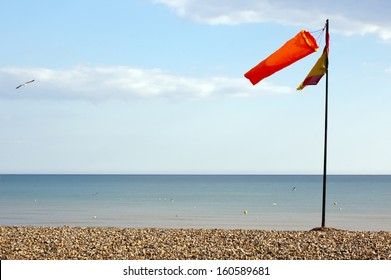 windsock against clear sky at seacoast, Brighton