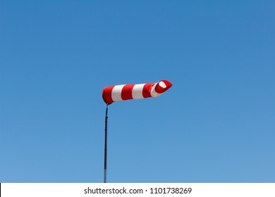 Windsock as a gauge for winds, wind vane on the aerodrome airfield on an air show