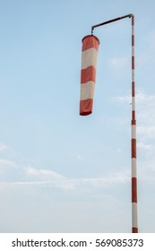 Windsock with no wind against a blue sky