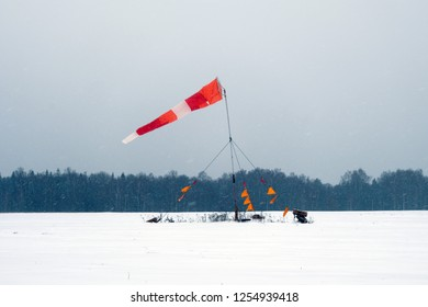 A windsock on the snowy field.