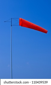 Windsock showing wind direction over blue sky