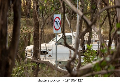 Windsor, Australia - March 25, 2021; A ute is trapped on a flooded road  in Windsor.  The floodwaters came well over the top of the vehicle.