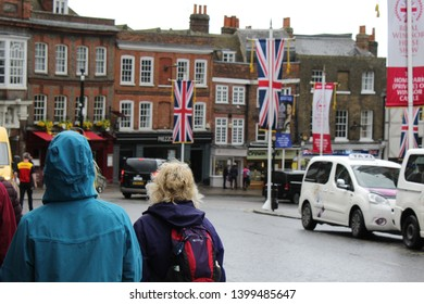 Windsor, Berkshire, England - 9 May 2019: Scene day after Harry & Megan presented their son, Archie, to the public at Windsor Castle.  It was a rainy day & few visitors in sight. Tourists & vehicles.