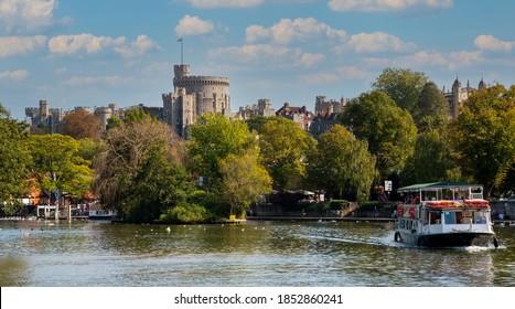 Windsor, Berkshire, England, UK. 2020. A tourist passeneger boat on the River Thames at Windsor, Berkshire, UK.