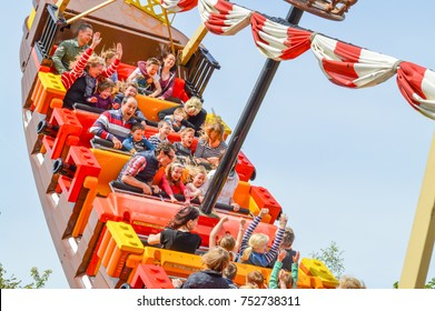 WINDSOR, BERKSHIRE. ENGLAND UK- APRIL 20 2016 : Legoland resort. People enjoying one of the many rides at Legoland Theme park.Family fun on holidays.