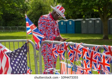 Windsor, Berkshire, UK - May 18 2018 : Man in union jack suit and Stetson stands on the Long Walk in Windsor surrounded by UK and American flags at the Royal Wedding of Prince Harry and Meghan Markle