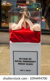 Windsor, Berkshire, UK - May 18 2018 : A spare pair of shoes in a glass case in the event of a shoe emergency ahead of the Royal Wedding of Prince Harry to Meghan Markle in Windsor