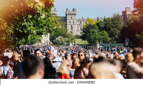 WINDSOR, BERKSHIRE, UNITED KINGDOM - MAY 19, 2018: Thousands in front of Windsor Castle during royal wedding marriage celebration of Prince Harry and actress from Suits Ms Meghan Markle