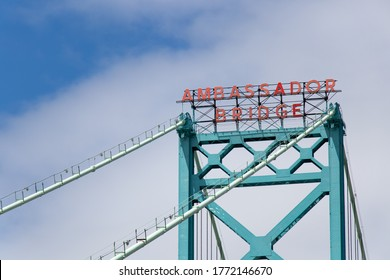Windsor, Canada - May 21, 2020: Sign atop the Ambassador Bridge, US-Canada border crossing between Detroit and Windsor.