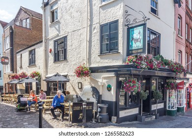 Windsor, England - 14th August 2015: People drinking outside the Horse and Groom. The pub has historical links.