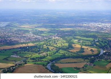 WINDSOR, ENGLAND -21 AUG 2019- Aerial view of the town of Windsor and the Windsor Castle, property of the British Monarchy in Windsor, England, United Kingdom.