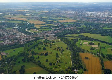 WINDSOR, ENGLAND -28 JUL 2019- Aerial view of the town of Windsor and the Windsor Castle, property of the British Monarchy in Windsor, England, United Kingdom.