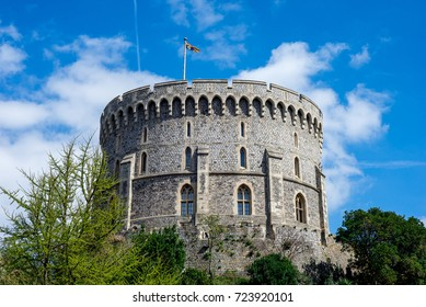 Windsor, England, April 2017: Round Tower with a raised flag in Windsor Castle, county of Berkshire