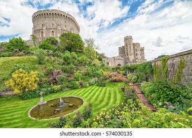 WINDSOR, ENGLAND - JULY 10, 2016: Summer view for castle gardens in Medieval Windsor Castle. Windsor Castle is a royal residence at Windsor in the English county of Berkshire, built in 1066 year