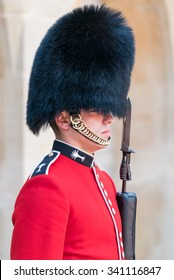WINDSOR, ENGLAND - JULY 24: Royal Guard holding gun on duty pictured on July 24th, 2015, in Windsor Castle, Windsor, UK. Windsor castle is one of the official residences of the British Royal Family.