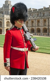 WINDSOR, ENGLAND - JULY 26: Royal Guard holding gun on duty in Windsor Castle, one of the official residences of the British Royal Family.