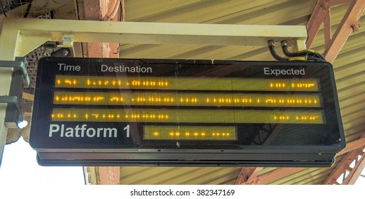 WINDSOR, ENGLAND - JUNE 5, 2015:  Old electronic scoreboard, giving passengers required information on arrival and departure at the  Windsor train station