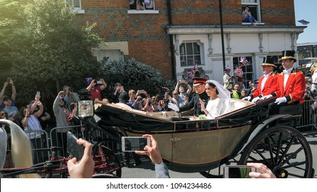 WINDSOR, ENGLAND - MAY 19 2018: Prince Harry, Duke of Sussex and Meghan, Duchess of Sussex Windsor Castle in Ascot Landau carriage during a procession after getting married at St Georges Chapel flare