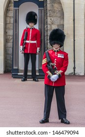 WINDSOR, ENGLAND - MAY 27: Changing Guard Ceremony takes place in Windsor Castle on May 27, 2013, Windsor, England. British Guards in red uniforms are among the most famous in the world.