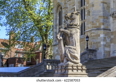 WINDSOR, GREAT BRITAIN - MAY 19, 2014:It is a statue of a unicorn holding a shield with a coat of arms at the Chapel of St. George at Windsor Castle.