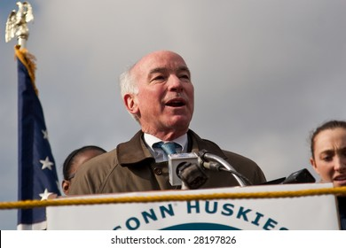 WINDSOR LOCKS, CT - APRIL 8: US Rep Joseph Courtney speaks to the crowd to welcome the UCONN Women's Basketball NCAA Champs at a homecoming rally held at Bradley Airport on April 8, 2009 in CT.