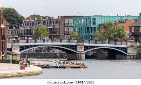 WINDSOR, MAIDENHEAD & WINDSOR/UK - JULY 22 : People crossing a bridge in Windsor, Maidenhead & Windsor on July 22, 2018. Unidentified people