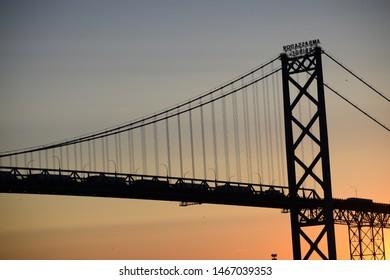 Windsor, ON - June 2019: Detroit Windsor Ambassador Bridge at sunset. Border crossing Canada USA