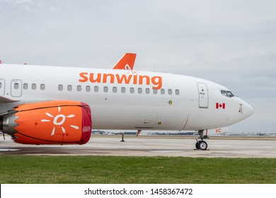 WINDSOR, ONTARIO - April 16, 2019: Ground Sunwing Airlines Boeing 737 MAX seen parked at Windsor International Airport,