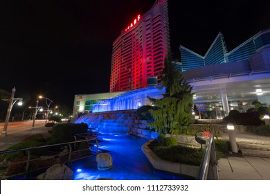 Windsor, Ontario / Canada - September 9, 2017: Caesars Windsor casino in Windsor, Ontario taken at night with illuminated waterfalls.