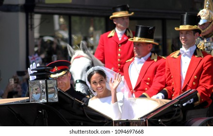 Windsor, Uk - 19/5/2018: Prince Harry and Meghan Markle wedding carriage procession through streets of Windsor then back the Windsor Castle waving to crowd