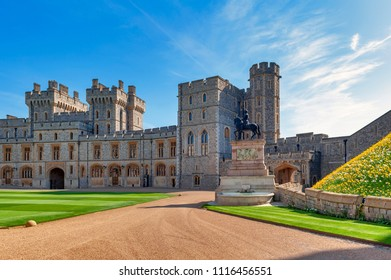 Windsor, UK - April 2018: Group of buildings with King Charles II Statue at The Upper Ward and The Quadrangle of Windsor Castle, a royal residence at Windsor in county of Berkshire, England, UK