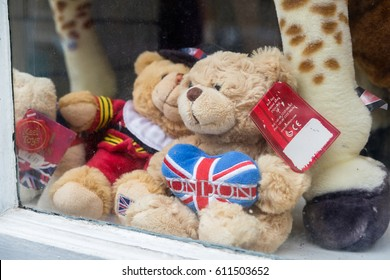 WINDSOR, UK - MARCH 18, 2017: Teddy bears in a souvenir shop window in the popular tourist town on Windsor in March 2017.