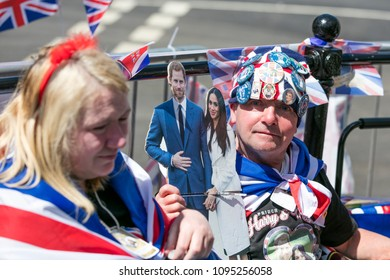 WINDSOR, UK - MAY 17th 2018: Royal supporters dressed in unon jacks and memorabilia in Windsor ahead of the Royal Wedding of Prince Harry and Meghan Markle