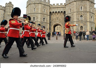 WINDSOR, UNITED KINGDOM - APRIL 22, 2014: British Queen's Guards perform the changing of the Guard in front of the entrance of Windsor Castle at the foot of Castle Hill on April 22, 2014 in Windsor.