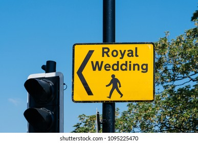 WINDSOR, UNITED KINGDOM - MAY 19, 2018: Royal Wedding yellow street sign with arrow for pedestrians to follow to marriage of Prince Harry, Duke of Sussex and the Duchess of Sussex Meghan Markle