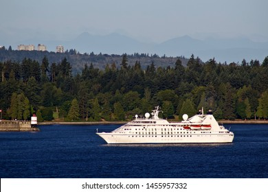 Windstar Star Legend cruise ship in Burrard inlet with Vancouver city skyline.  Vancouver BC/Canada/July 18th, 2019