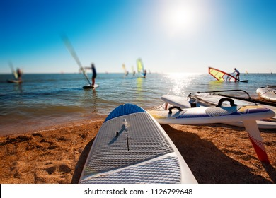 Windsurf boards on the sand at the beach. Windsurfing and active lifestyle