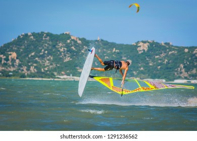 windsurfer athlete performing extreme windsurfing tricks and jumps in Phan Rang Vietnam