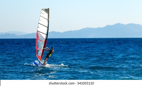 windsurfer in the background of mountains in the distance. summer Sunny day. Greece, Rhodes