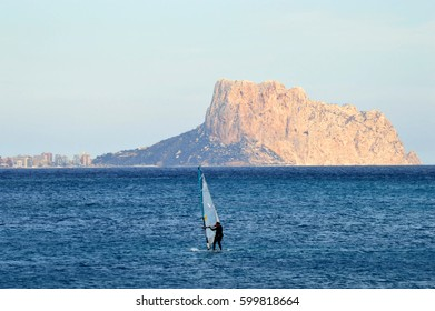Windsurfer on the Mediterranean Sea with skyline in the background