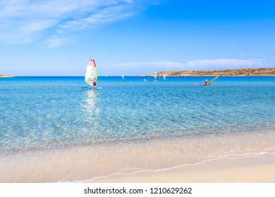 Windsurfer on sea in beautiful bay with beach, Karpathos island, Greece