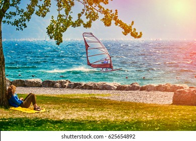 Windsurfer pro-rider surfing at high speed on Lake Garda, italy