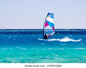windsurfer rides on the waves of the Red Sea