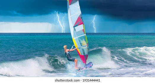 Windsurfer surfing the wind on waves, strom and lightning in the background  - Alacati, Cesme, Turkey