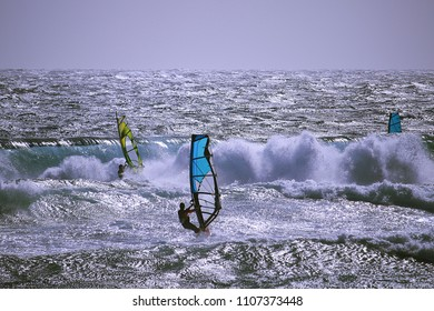 Windsurfers at the Atlantic ocean on a big day with big waves