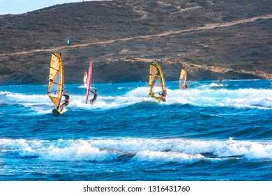 Windsurfers and kitesurfers ride on Prasonisi beach (Rhodes, Greece)