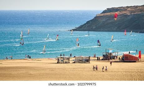 Windsurfers and kitesurfers riding at the Prasonisi kite beach at Rhodes island